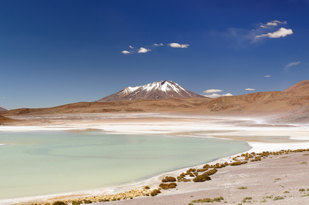 surreal landscape: South America - Bolivia. The surreal landscape is nearly treeless, punctuated by gentle hills and volcanoes near Chilean border. The picture present lagoon Kota