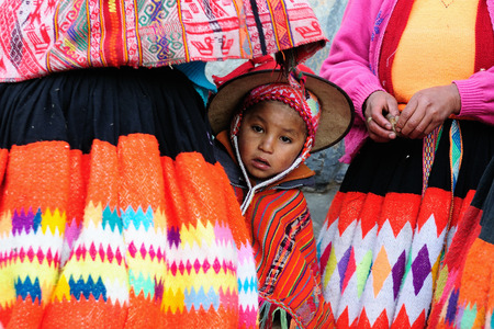 sacred valley: CUSCO, PERU - APRIL 04: Sad and poor Peruvian children in traditional garments in the Sacred Valley in South America in April 04, 2012