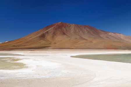 surreal landscape: South America - the most beautifull Andes in  Bolivia,. The surreal landscape is nearly treeless, punctuated by gentle hills and volcanoes near Chilean border Stock Photo