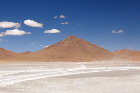 surreal landscape: South America - Bolivia. The surreal landscape is nearly treeless, punctuated by gentle hills and volcanoes near Chilean border Stock Photo