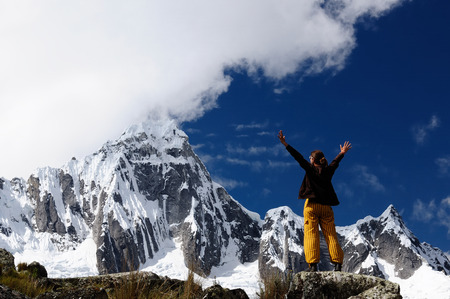 Woman in the Peruvian high Andes on the trekking Santa Cruz on the Cordillera Blanca mountains