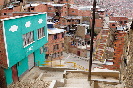 South America, La Paz - the governmental capital of Bolivia. The citys building cling to the sides of the canyon and spill spectaculary downwards