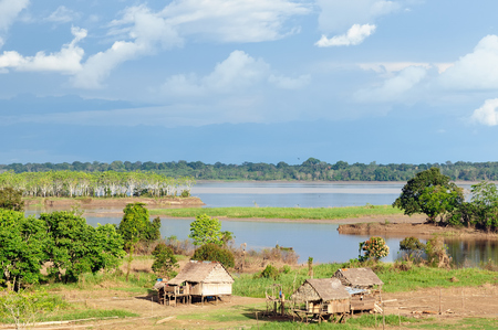 tribes: Peru, Peruvian Amazonas landscape. The photo present typical indian tribes settlement in the Amazon Stock Photo