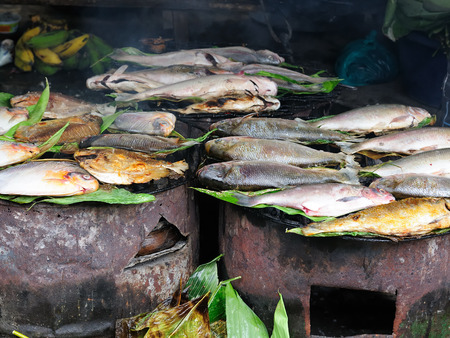 city fish market: South America, Fried fish on the market in the Iquitos major city in Amazonia, Peru Stock Photo