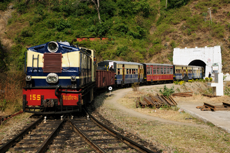The mountain toy train from Kalka to Shimla. It is tourist attraction in India, with beautiful wiev on the Hymalaya mountains. UNESCO