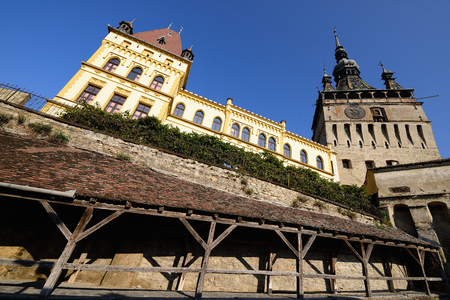 Fragment of the old town in Sighisoara in Romania. Clock tower