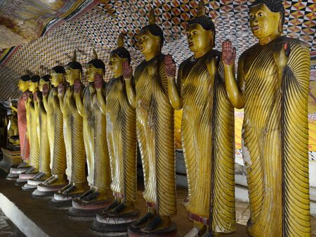 Inside of caves in ancient Buddhist complex in Dambulla cave temple. Sri Lanka. The photograph is presenting the statue of Buddha Editorial
