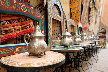 Decorative elements on the souk (market) in the old town, Medina in Morocco. Jug for brewing the tea. Stock Photo - 74549856