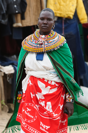 MARARAL, KENYA - JULY 03: African woman from the Samburu tribe with characteristic decorative necklaces on the market in the Mararal town in Kenya, Mararal in July 03, 2013