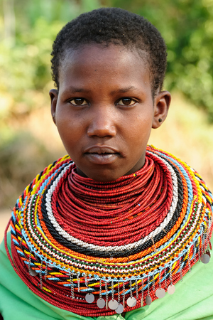 SOUTH HORR, KENYA - JULY 08: Young African girl from the Samburu tribe with characteristic decorative necklaces on the market in Kenya, South Horr in July 08, 2013 Editorial