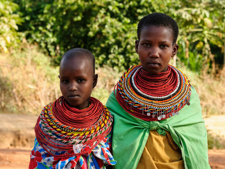 characteristic: SOUTH HORR, KENYA - JULY 08: Young African girls from the Samburu tribe with characteristic decorative necklaces on the market in Kenya, South Horr in July 08, 2013