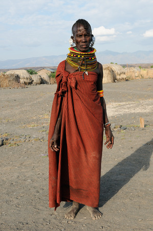 LOIYANGALANI, KENYA - JULY 10: African woman from the Turkana tribe in the traditional dress in transit to the market in Kenya,Loiyangalani in July 10, 2013 Editorial