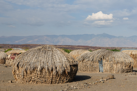 Traditional round house of people from the Turkana tribe on the shore of the lake Turkana in Kenya Stock Photo