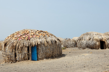Traditional round house of people from the El Molo tribe on the shore of the lake Turkana in Kenya Stock Photo