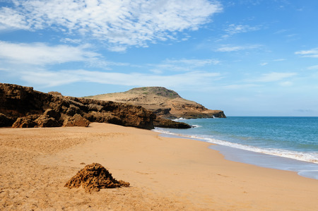 One of an more beautiful pristine  Pilon de Azucar beaches in Colombia on Peninsula La Guajira. Caribbean coast with turquoise water and orange sand