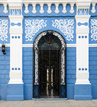 Facade of the colonial building  in the Camaguey town on Cuba Stock Photo