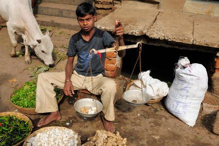 puri: PURI, INDIA - 17 DECEMBER 2009: Street vendor selling vegetables on the streets in Puri, Puri in December 17, 2010 Editorial