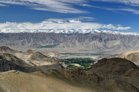 View of Leh from the road to the highest mountain pass in the world that can be reached by car. This pass is the goal of many tourist trips in Ladakh Stock Photo