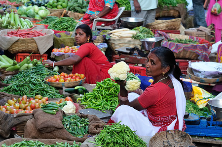 UDAJPUR, INDIA - 28 FEBRUARY 2010: Indian Colorfully women seling the vegetables on the street in India Editorial
