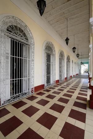 CIENFUEGOS, CUBA - 05 NOVEMBER 2016: Colonial building development by the main promenade on the old town in Cienfuegos on Cuba Editorial