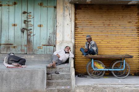 JUNAGADH, GUJARAT, INDIA - 18 JANUARY 2015: Afternoon siesta on streets of Indian cities