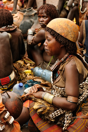 DIMEKA, OMO VALLEY, ETHIOPIA - 27 JULY 2013: The people from Hamer people on the local marketplace in Dimeka, Omo valley Editorial