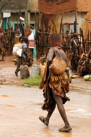 Local Ethiopian people coming back from the market from the Dimeka village in the Omo valley in Ethiopia Editorial