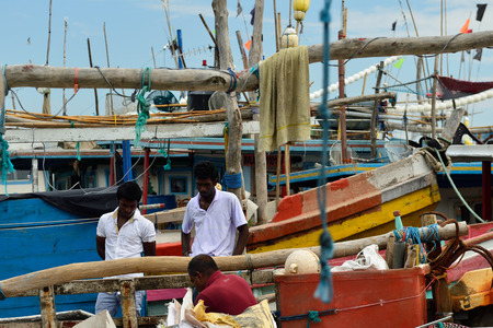TANGALLE, SRI LANKA - 26 FEBRUARY 2015: For seller of fresh fishes straight from the fishing in a fishing port in Tangalle