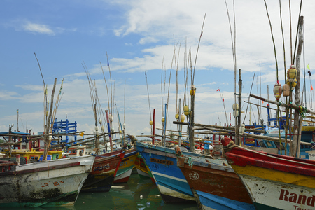 TANGALLE, SRI LANKA - 26 FEBRUARY 2015: Fishing cutters in the fishing harbour in Tangalle