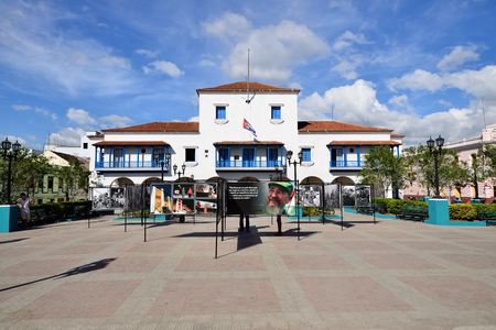 SANTAGO DE CUBA, CUBA  - 01 DECEMBER 2016: Exhibition of photographs from the life of Fidel organised after his death, on the main square Santiago, presenting moments from the life of the dictator