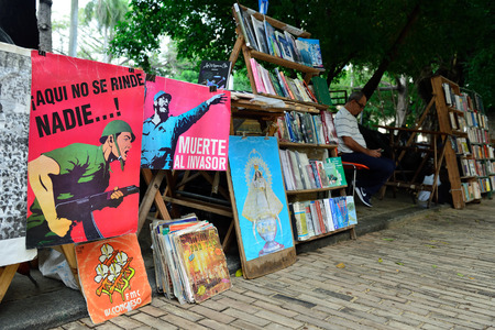 HAVANA, CUBA - 10 DECEMBER 2016: Revolutionary posters on the market of the antique in the historical centre of Havana Editorial