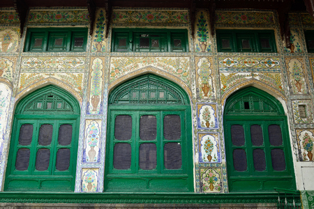 Detail of decorating the wall in a green uniquely wooden mosque, Shah E Hamdan in Srinagar, Jammu and Kashmir Stock Photo