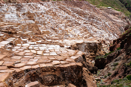 Pre Inca traditional salt extraction pans (Salinas) in Sacred Valley of Incas, Peru Imagens