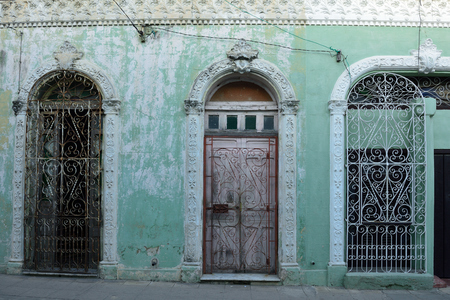 Facade of the colonial building in the Camaguey town on Cuba