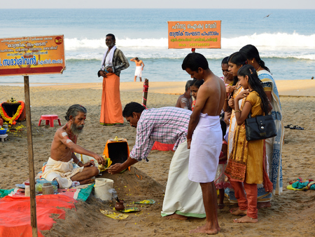 VARKALA, KERALA, INDIA - 18 MARCH 2015: Traditional morning Puja  in the holy place on Varkali beaches in the Kerala state in India