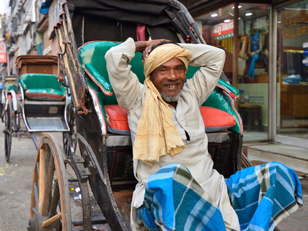 CALCUTTA, WEST BENGAL INDIA - 21 DECEMBER 2018: Rickshaw driver on crowded streets of Calcutta in the West Bengal