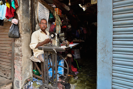 CALCUTTA, WEST BENGAL INDIA - 21 DECEMBER 2018: The tailors shop on crowded streets of Calcutta in the West Bengal