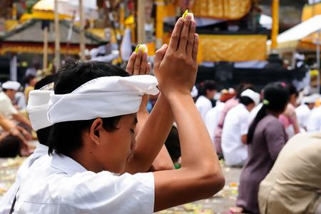 PURA TAMAN AYUN, BALI, INDONESIA - 01 APRIL 2011: Image of part of a Besakih hindu temple on Bali island, Hindu people during the prayer Editöryel