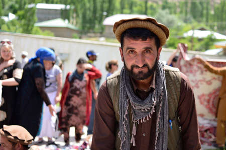 KHOROG, PAMIR MOUNTAINS, TAJIKISTAN - 06 JULY 2019: Portrait of the people of Afghanistan which is trading on the market in Tajikistan in the Pamir Mountains