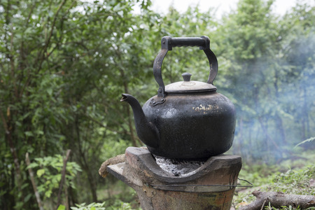 primus: Old vintage Kettle put on a fireplace