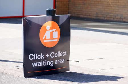Click collect online internet shopping sign at shop car park lane Standard-Bild