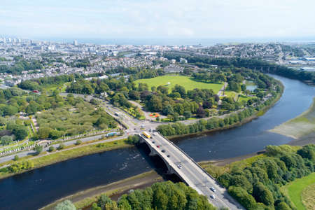 Aerial view of Aberdeen as River Dee flows in a curve to the North Sea showing Duthie Park with bridge and traffic from south