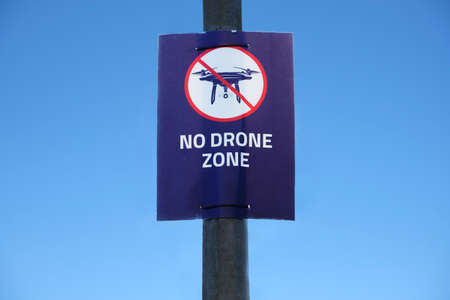 Drone in sky sign at British International Airport flying not allowed or permitted air zone uk
