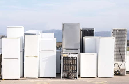 Old fridges freezers refrigerant gas at rubbish dump site to recycle and help environment and reduce pollution