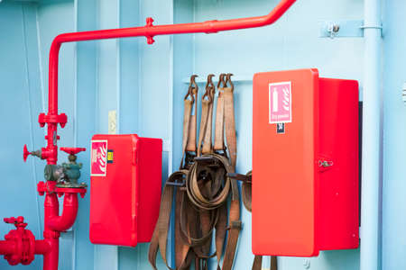 Dry powder fire extinguisher red cabinet on ferry ship