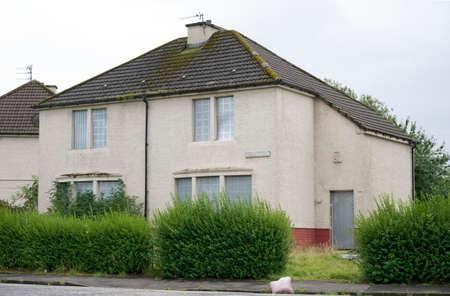 Derelict abandoned council house in poor housing crisis ghetto estate slum Paisley Stock Photo