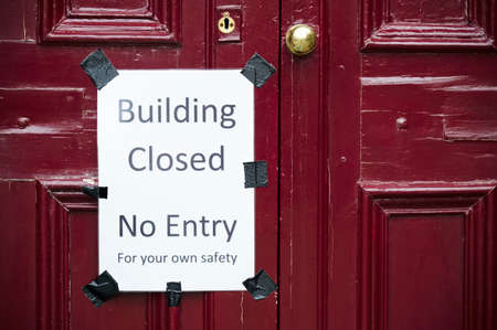 Building closed no entry sign on building door Imagens