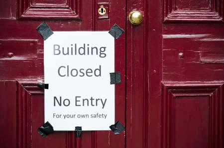 Building closed no entry sign on building door