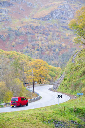 Camper van on dangerous bend in rural countryside