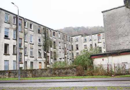 Derelict council house in poor housing estate slum with many social welfare issues in Port Glasgow